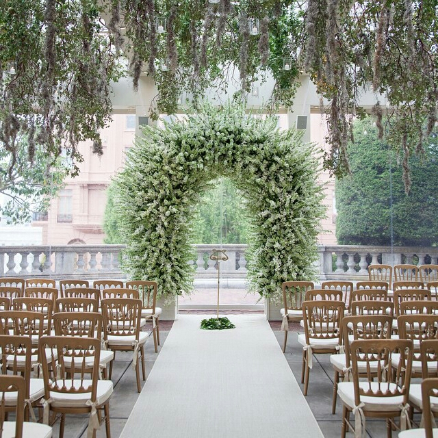 Image 3 elegant and lush green archway. image by @ samuellippkestudios