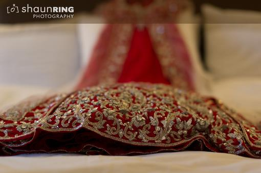 Indian Bride in Custom Red Dress and Diamond Necklace - 1
