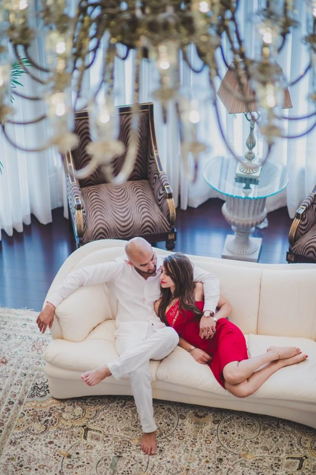 4 indian aerial engagement shoot couch red dress
