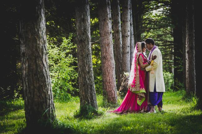 outdoor-indian-wedding-portrait-pink-bridal-lengha