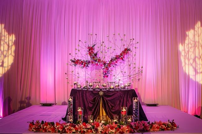 indian-wedding-reception-stage-pink-uplighting-floral-tree