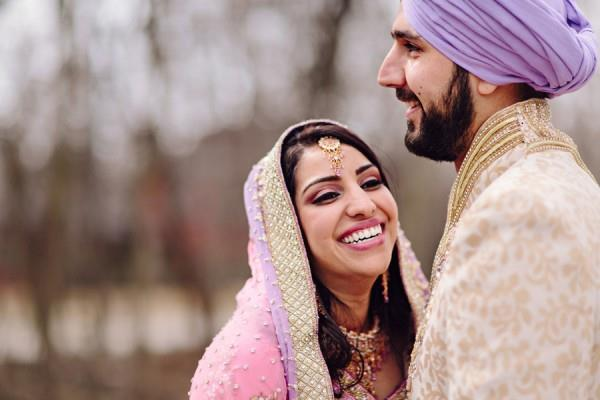 17a Indian Sikh wedding. Laughing couple