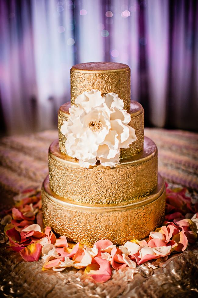 Gold gilded round 4 tier Indian wedding cake